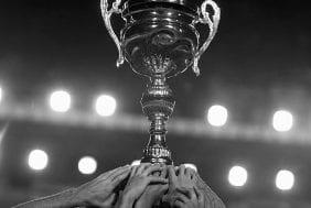 trophy-held-up-b&w